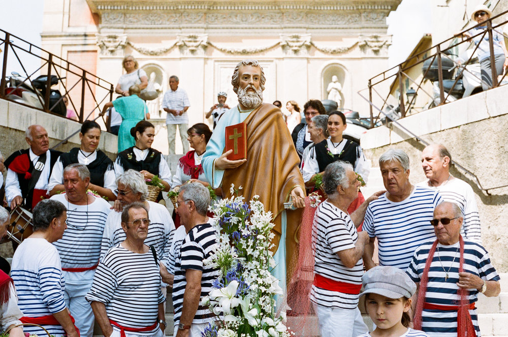 The Festival of St. Peter is a traditional celebration of the sea which begins with mass before a procession down to the seafront. Menton. France. 2018.