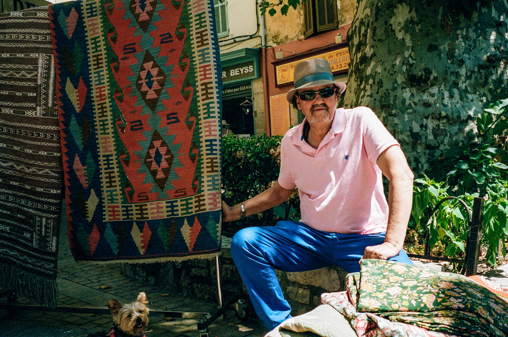 A rug trader shows me his wares, Lorgues. France. 2016.