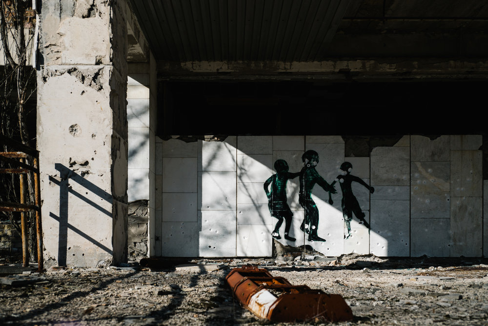 There are many painted silhouettes of children within the Exclusion Zone - Clifford Darby 2019