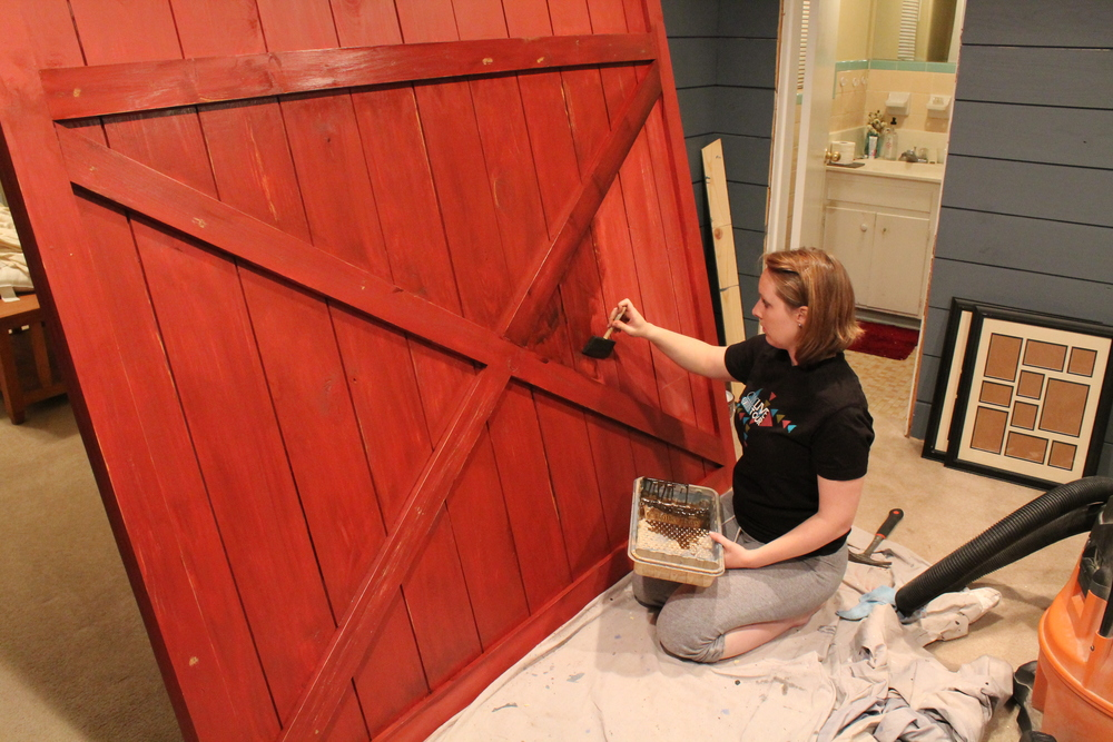 We Painted The Entire Door Barn Red, Leaving Some Streaks Unpainted For  Later Antiquing. We Used Steal Wool, High Grit Sand Paper And Nails To  Create The ...