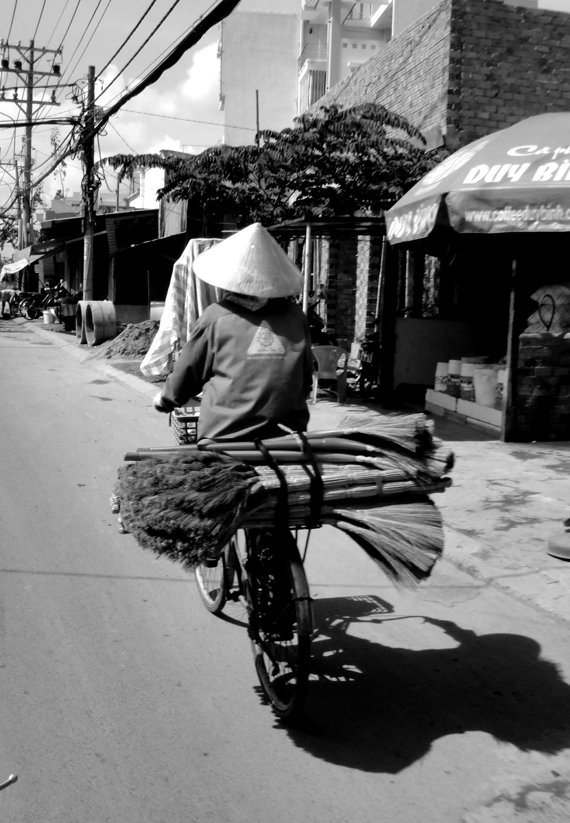 Vespas are not common transportation in Vietnam. Bikes and mopeds are.