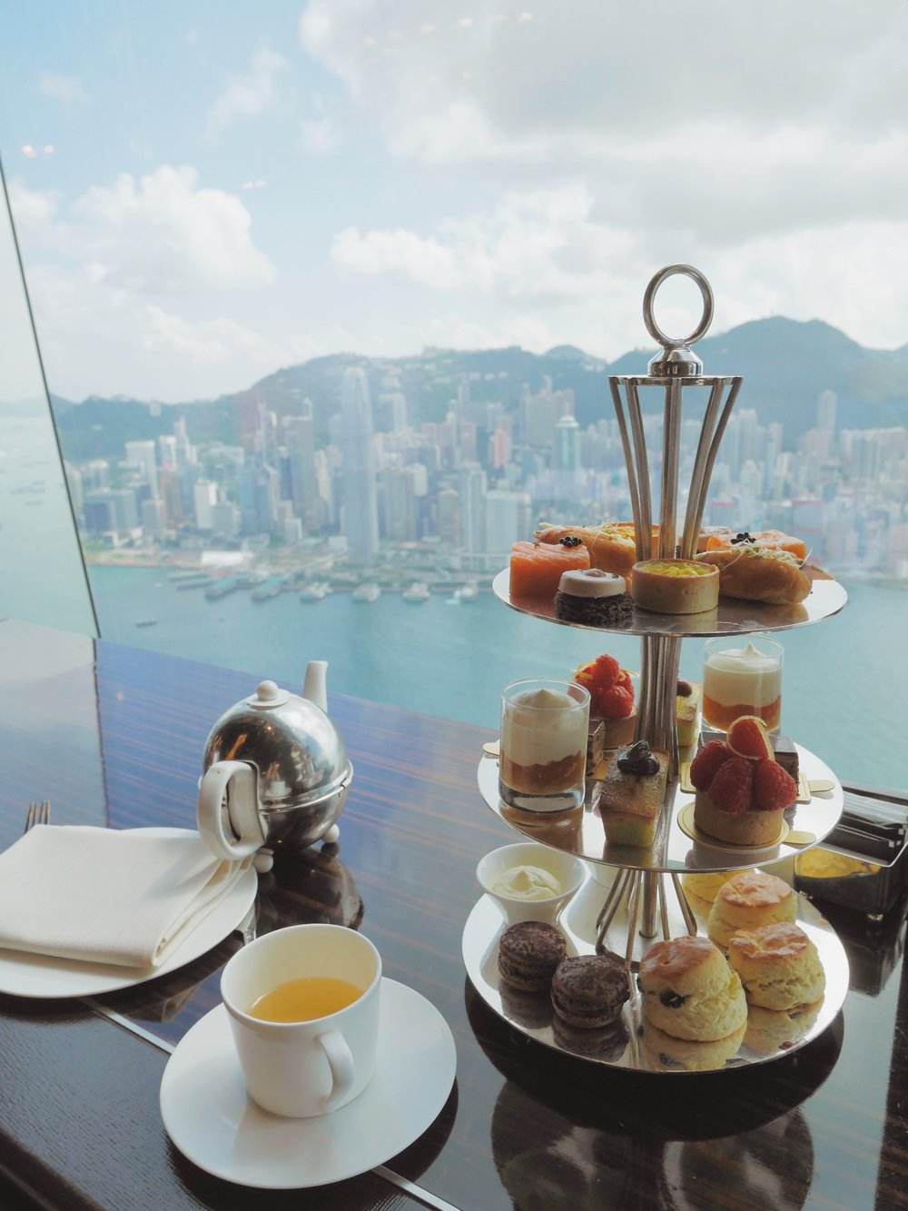 The tea for 2 is served with 2 drinks (TWG Tea) and a set of savory, sweet treats, scones and a view of Hong Kong, 102 stories up.