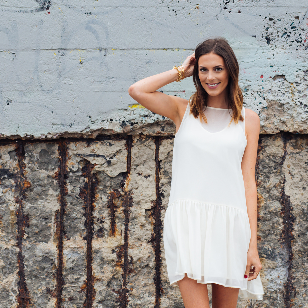 The perfect shift dress by Emily of Cupcakes and Cashmere | www.TheFourThreads.com