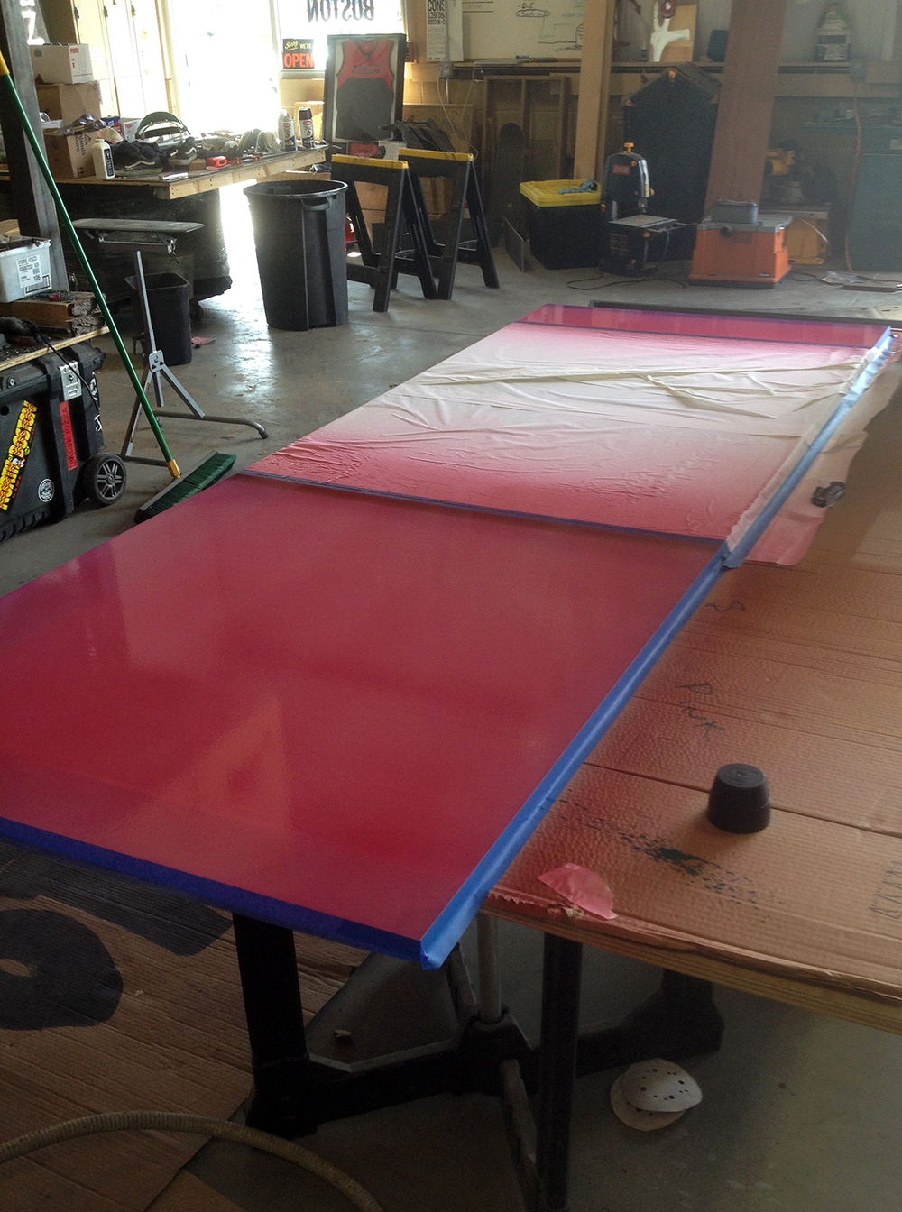 Spray finishing the final color on the table underside.