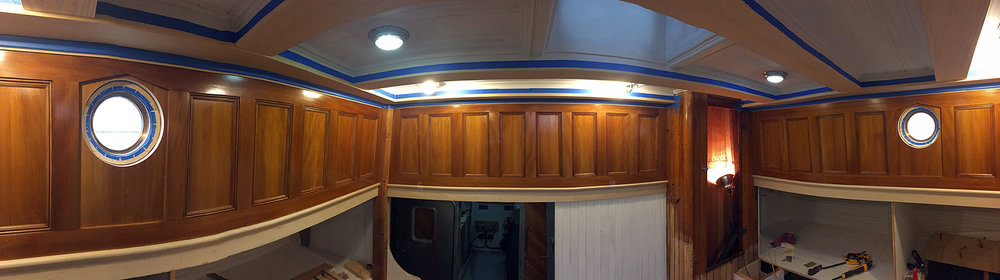 The Captain's quarters after panel installation and prior to trim and ceiling staining.