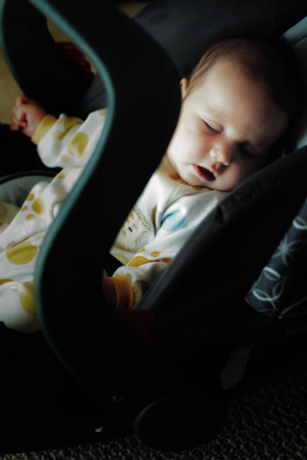Iris in her car seat