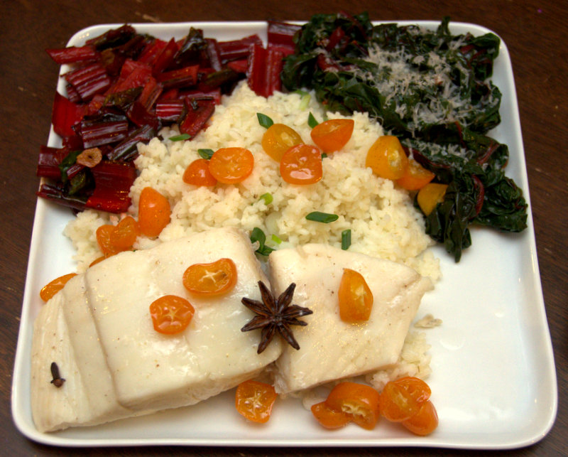 Whey-poached halibut with Carolina gold rice, sauteed chard and candied kumquats