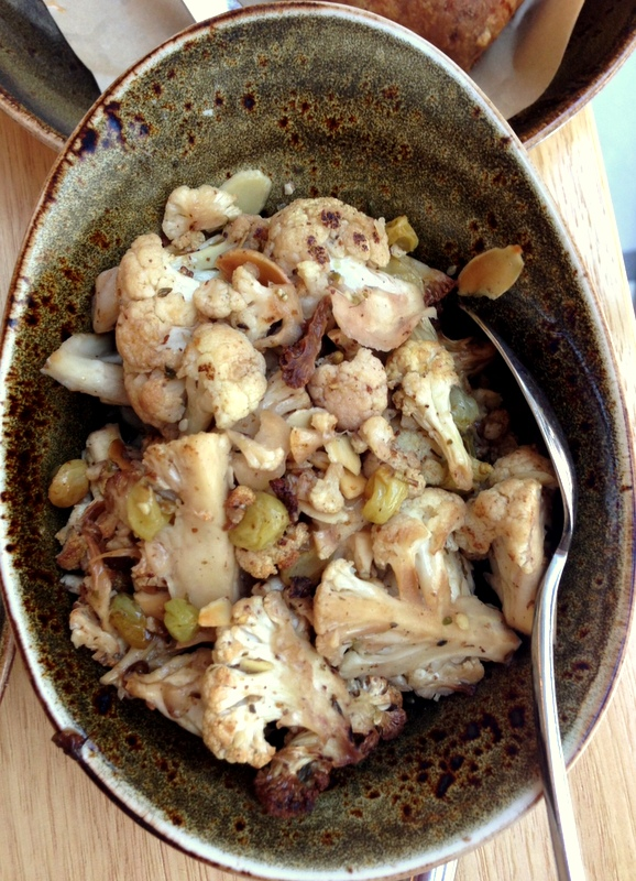 cauliflower with za'atar, golden raisins and almonds