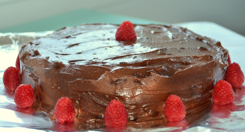 chocolate cake with chocolate-sour cream frosting and raspberries