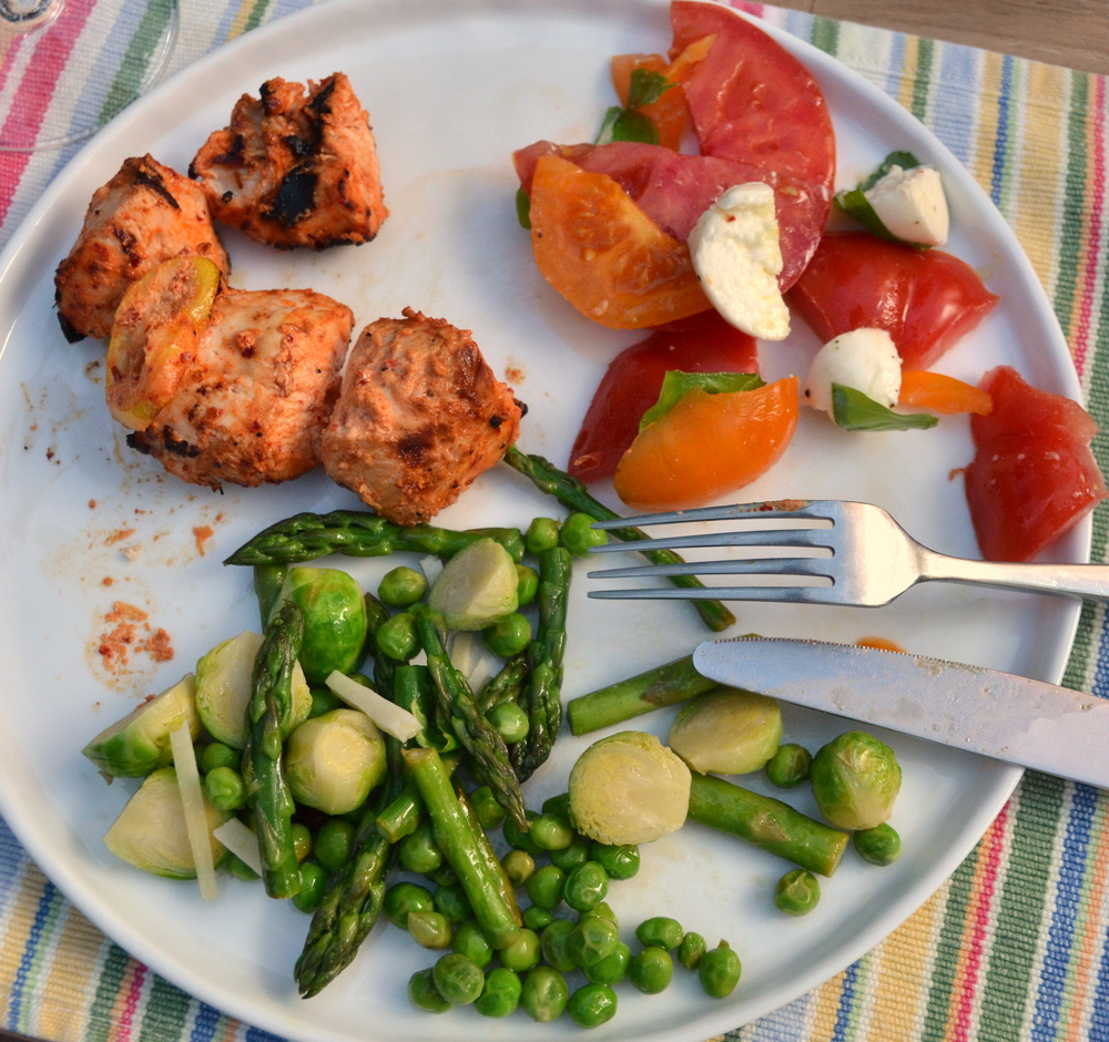 yogurt chicken with aleppo and lemon, caprese salad, sauteed asparagus/english peas/Brussels sprouts and pecorino