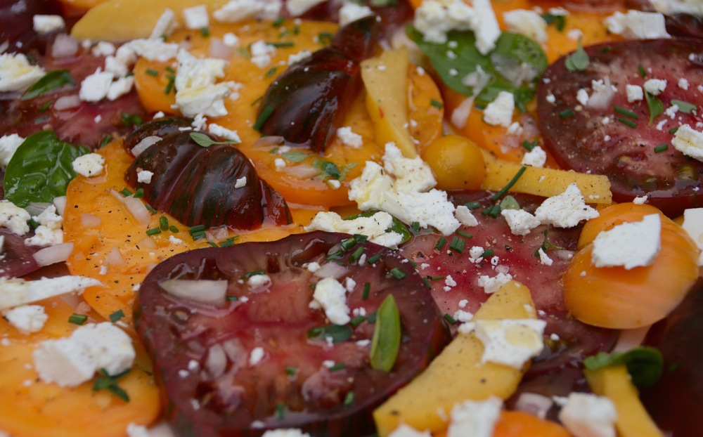 Heirloom tomato, peach, herb and chevre salad with shallots and apple vinaigrette.