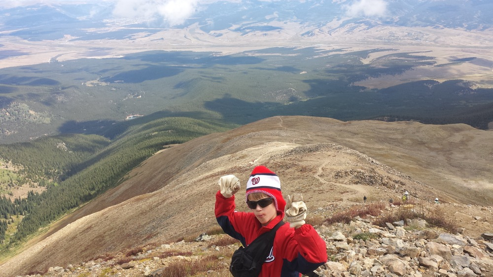 Jack atop Mt. Elbert; no, I don't know what's all around his mouth.