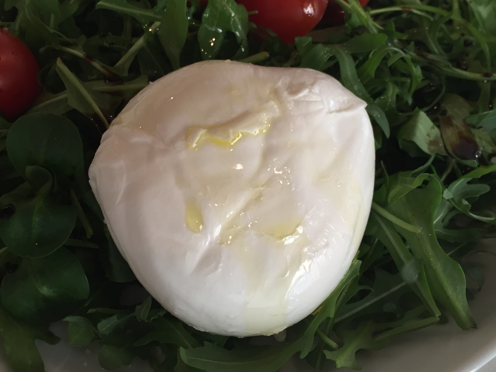 Mozzarella dripping with fresh oil and sprinkled with salt.