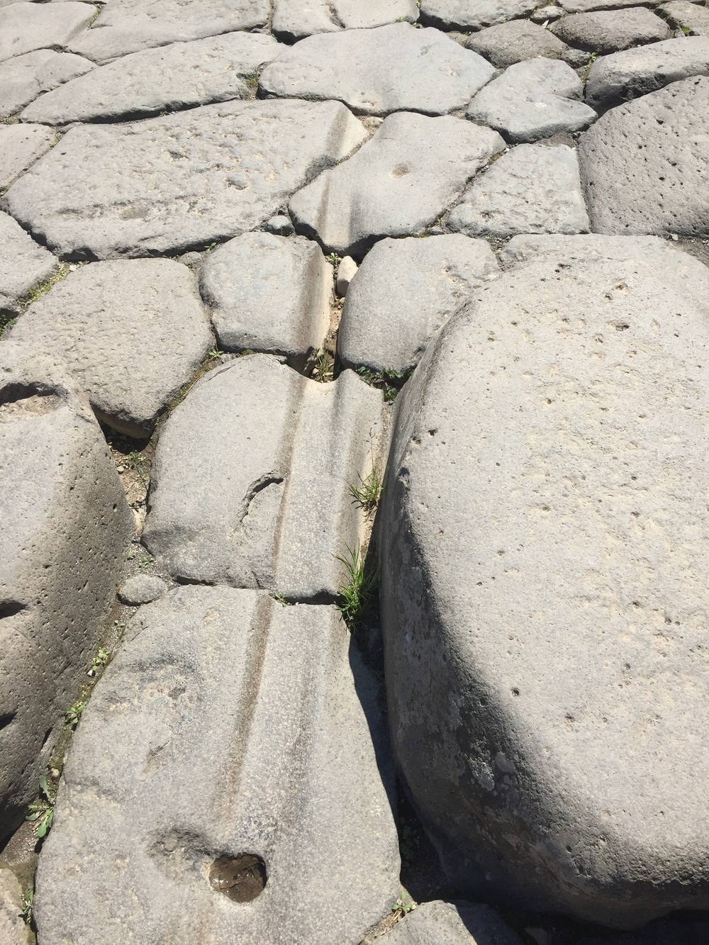 Ruts worn in the paving stones by carts over the years