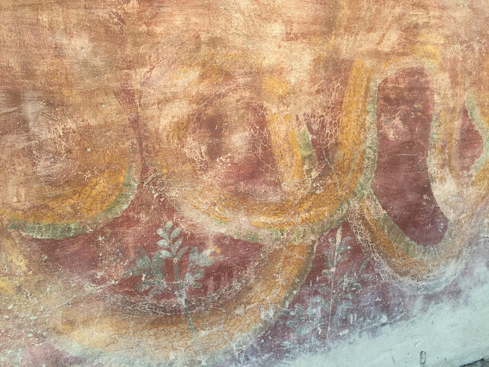 A snake fresco before the brothel; you should see the menu of options folks had!