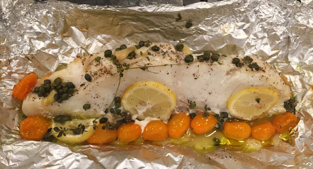 Dressed with garlic olive oil and cherry tomatoes and then cooked en papillote.