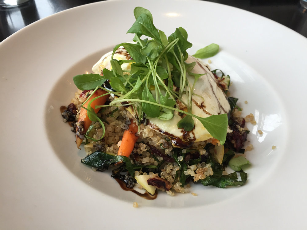 a hearty breakfast of quinoa, warm veggies, micro greens, balsamic drizzle, and a fried egg; at the Bartlett Pear Inn