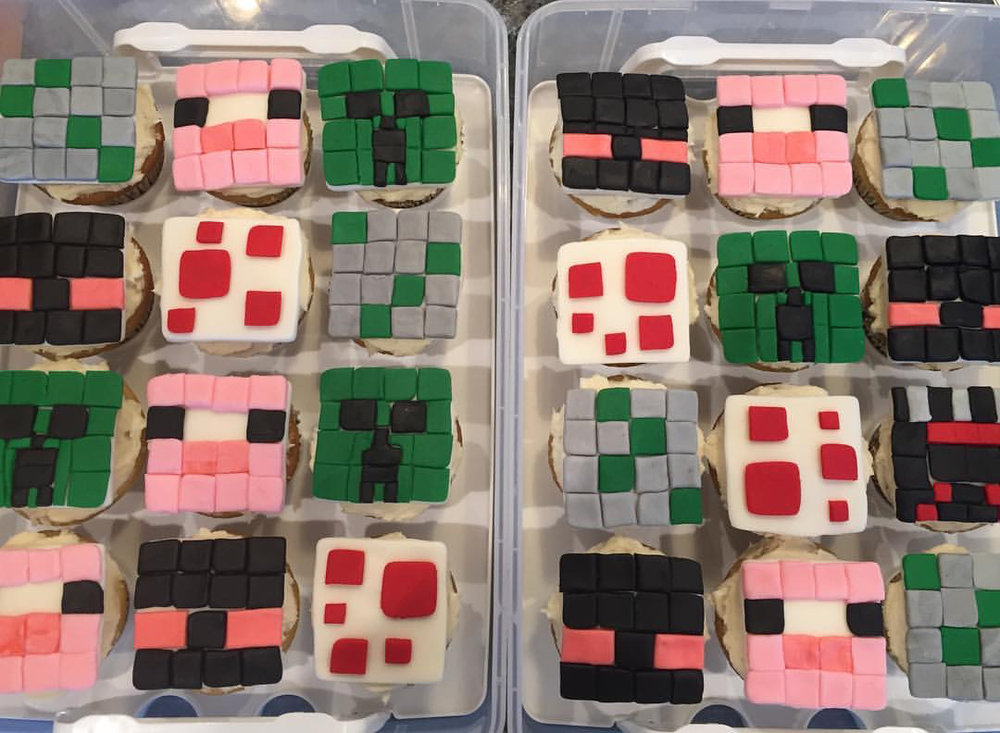 The Minecraft cupcake toppers I made out of fondant. These went to Ol's classroom for that celebration. Now working on his actual cake.