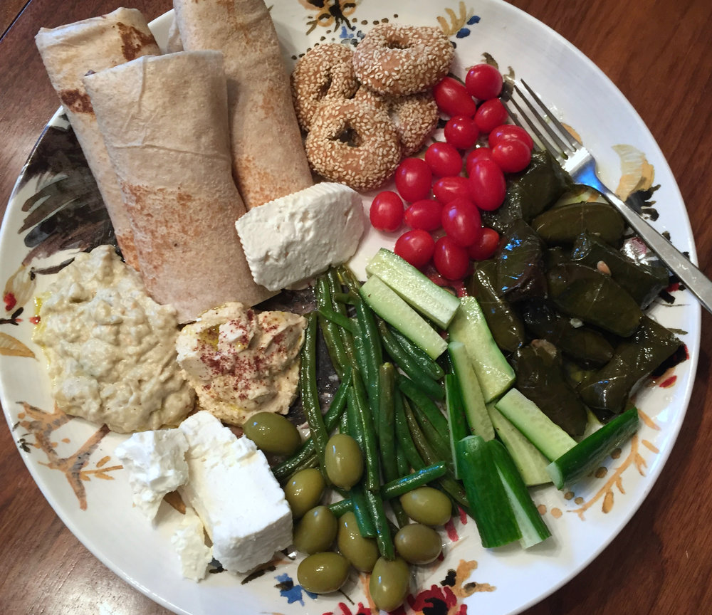 dinner: baba ganoush, hummus, Greek olives, green beans with lemon, cucs, stuffed grape leaves, tomatoes, two types of feta, ladokoulouro, village bread, all drizzled with kalamata oil
