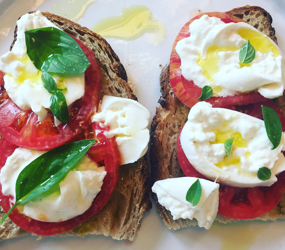 pain de campagne, burrata, tomatoes, basil, and great olive oil