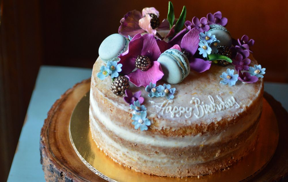 Custom dairy free cake with handmade edible flowers