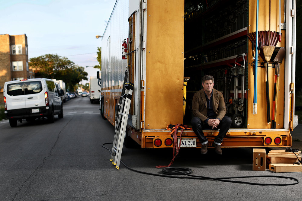 Adam Stockhausen in a prop truck on a Chicago street. For the New York Times Style Magazine.