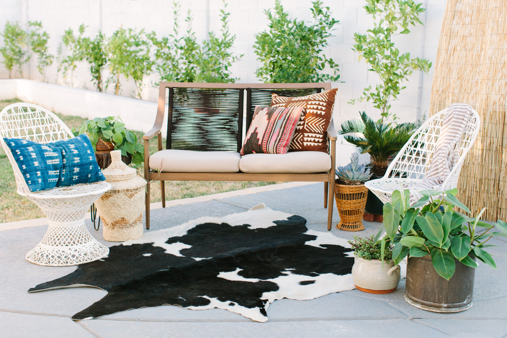 Coley's backyard is a boho oasis. I love how she combines old vintage pieces with new furniture.
