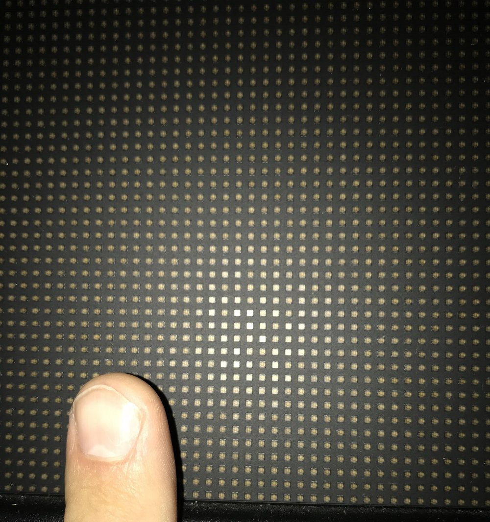 "My index finger held up against the screen. If you look closely you can see the 4 LED lights inside each ""pixel""."