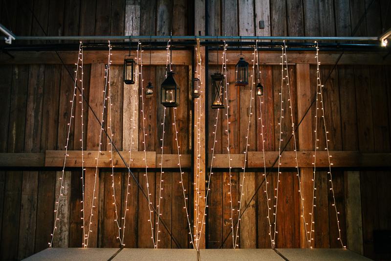 wedding string lights in barn