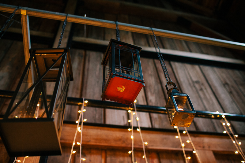 hanging lanterns at wedding in barn