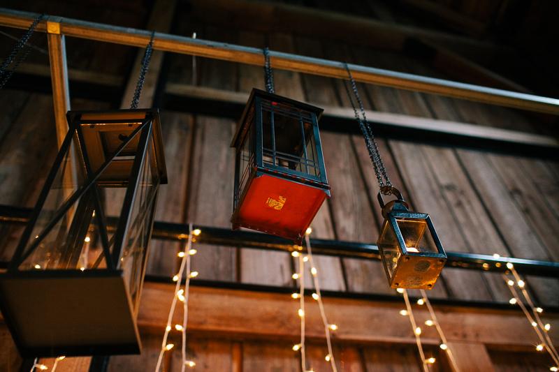 hanging lanterns at wedding in barn