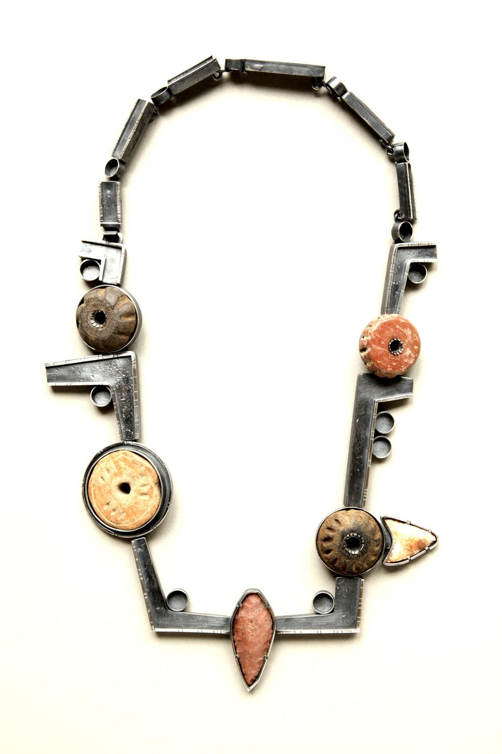 STONES AND WHORLS neckpiece of silver, Guatemalan clay spindles, stone, 30.48 x 16.51 x 1.27 centimeters.