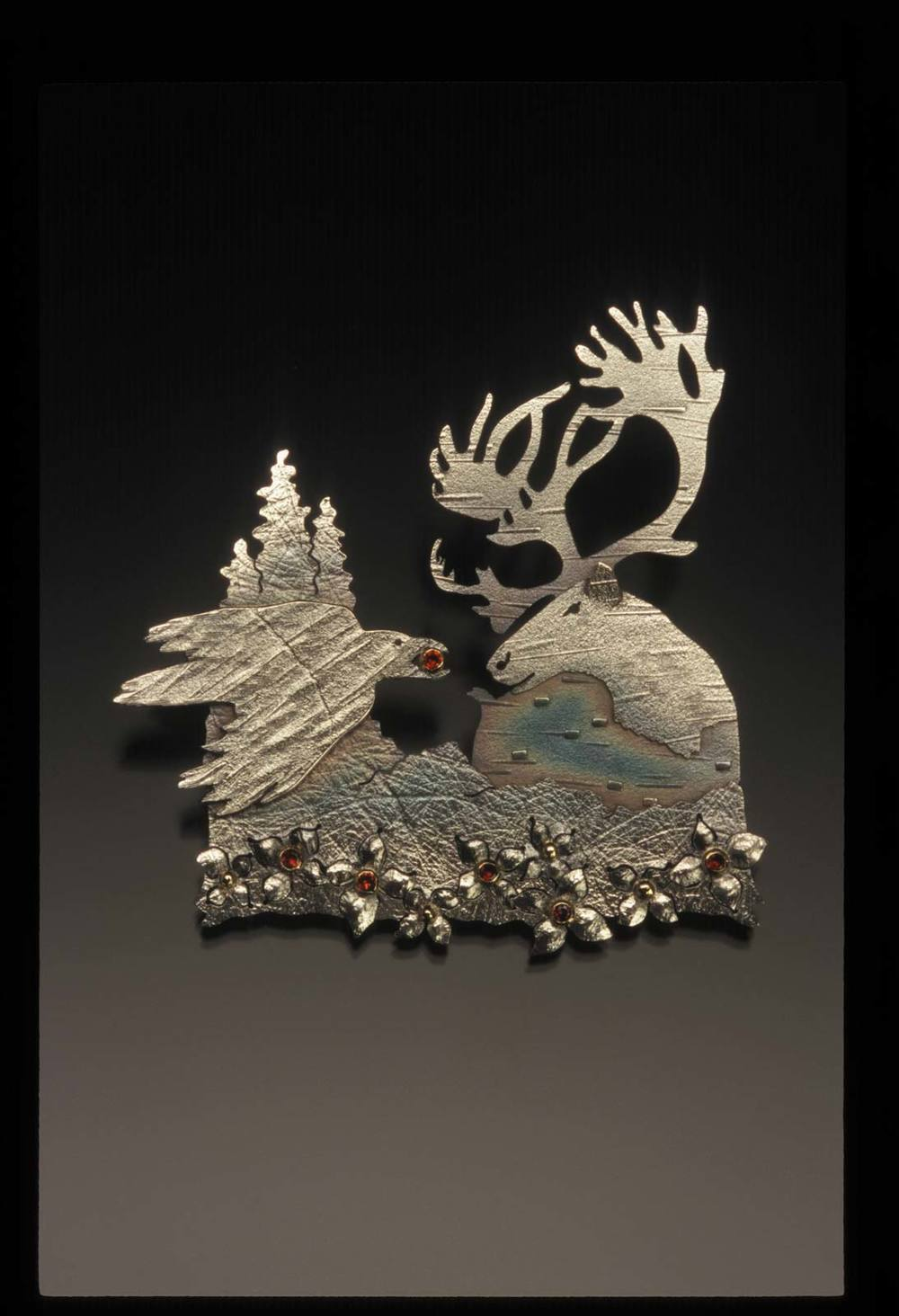 RAVEN AND CARIBOU: A DENA'INA STORY pendant of sterling silver, fourteen karat gold and garnets, 6.03 x 8.26 x 0.64 centimeters, 2007.