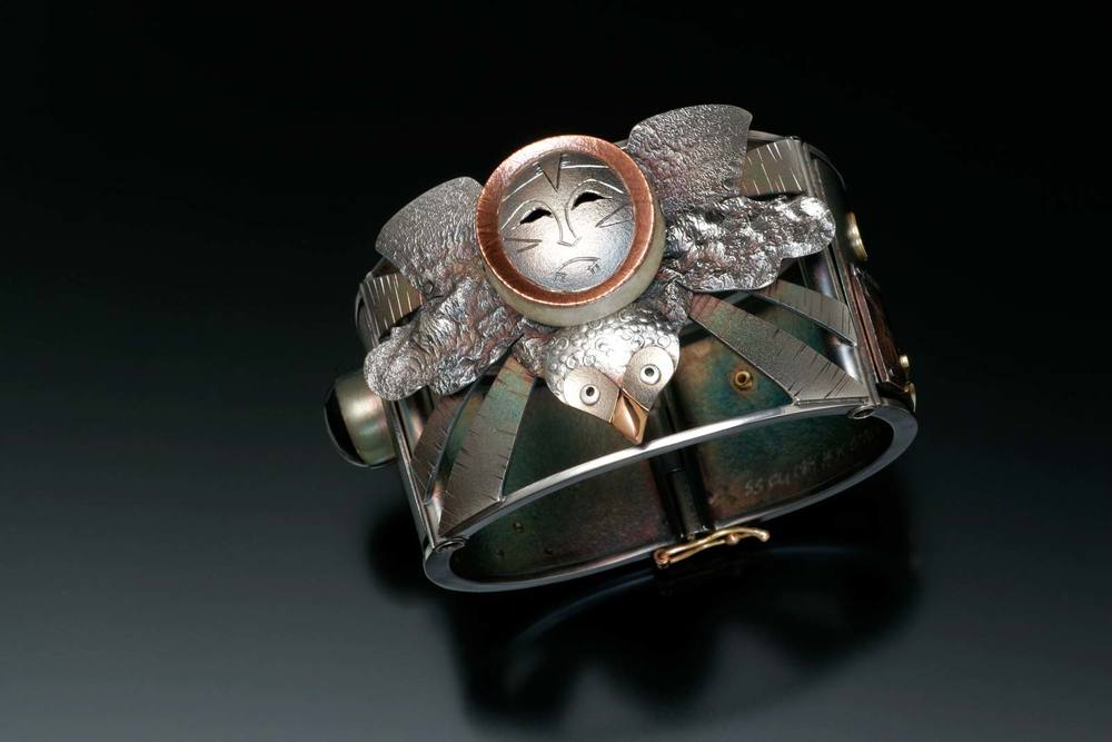 OWL MASK SPIRIT HELPER bracelet of sterling silver, fourteen and eighteen karat gold, mokume gane, 4.13 x 6.99 x 6.67 centimeters, 2008.