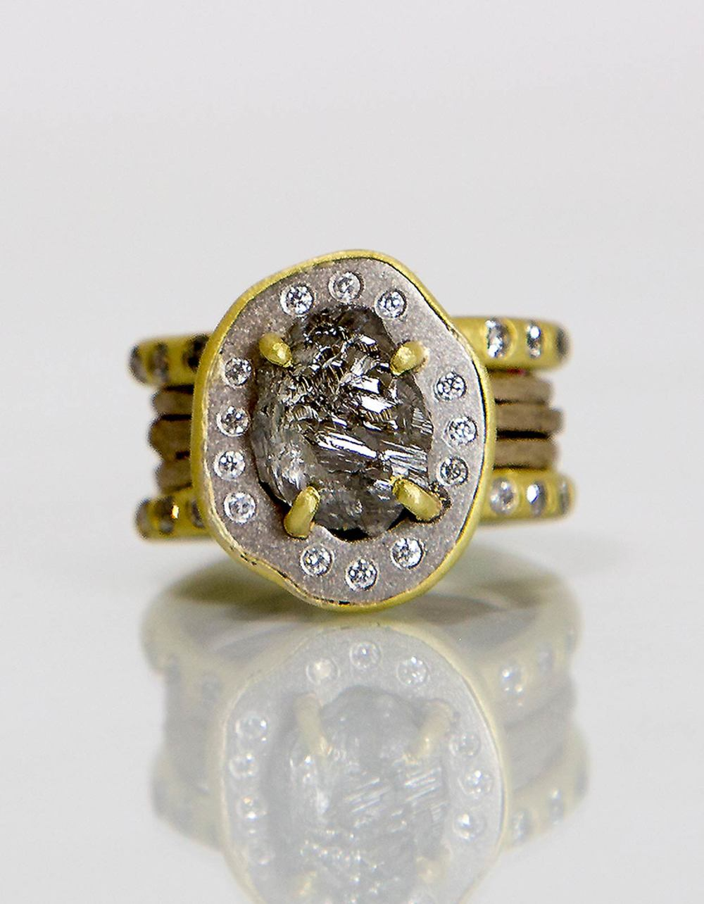 NATURAL GRAY DIAMOND RING of platinum, eighteen karat gold, diamonds, rough diamond, 2014. Photograph by Shannon Partrick.