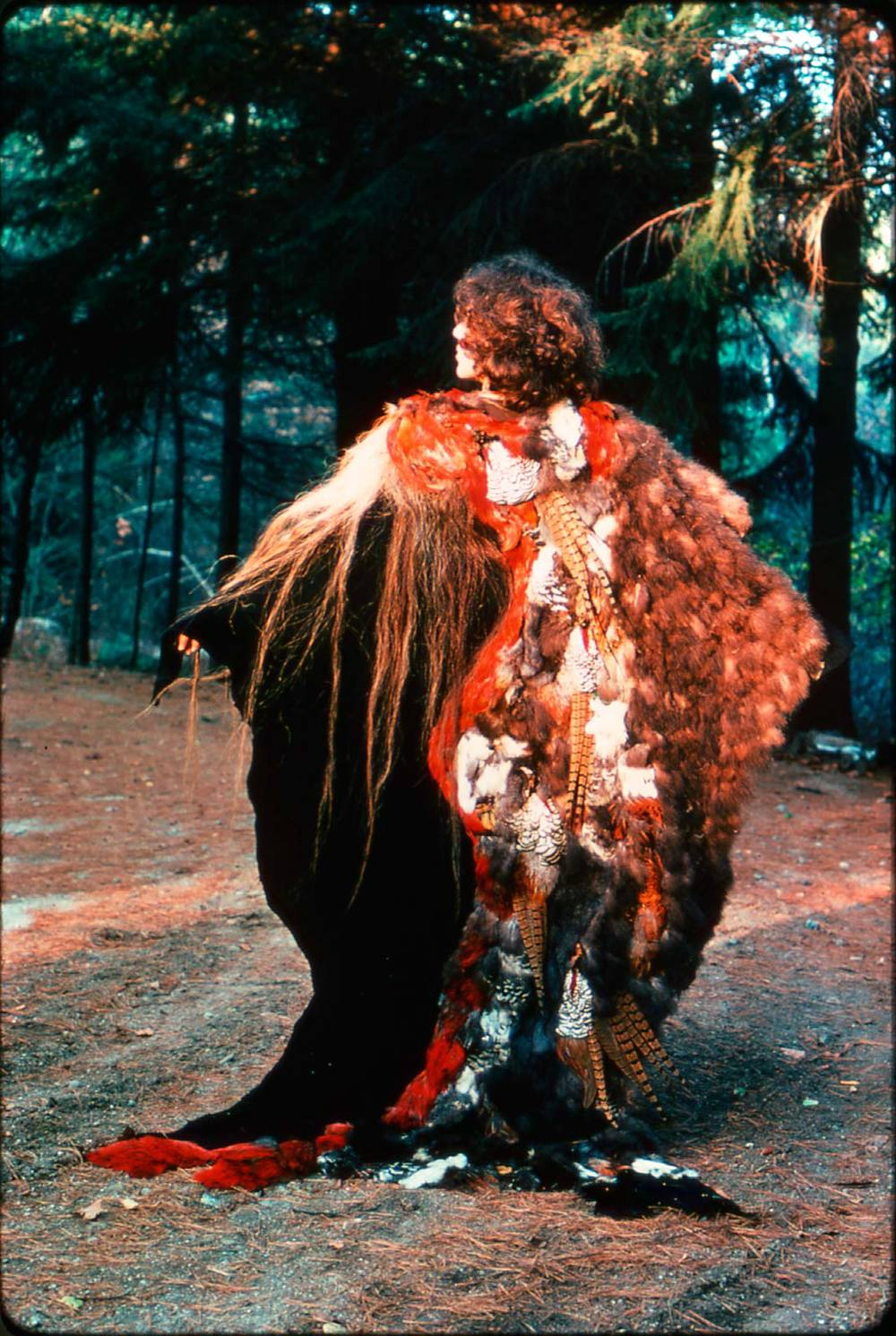 "CAPE, SHAMAN'S ROBE of feathers, horsehair and leather, worn by Nicki Marx, and exhibited in ""California Design '76,"" 1975. Photographer unknown."