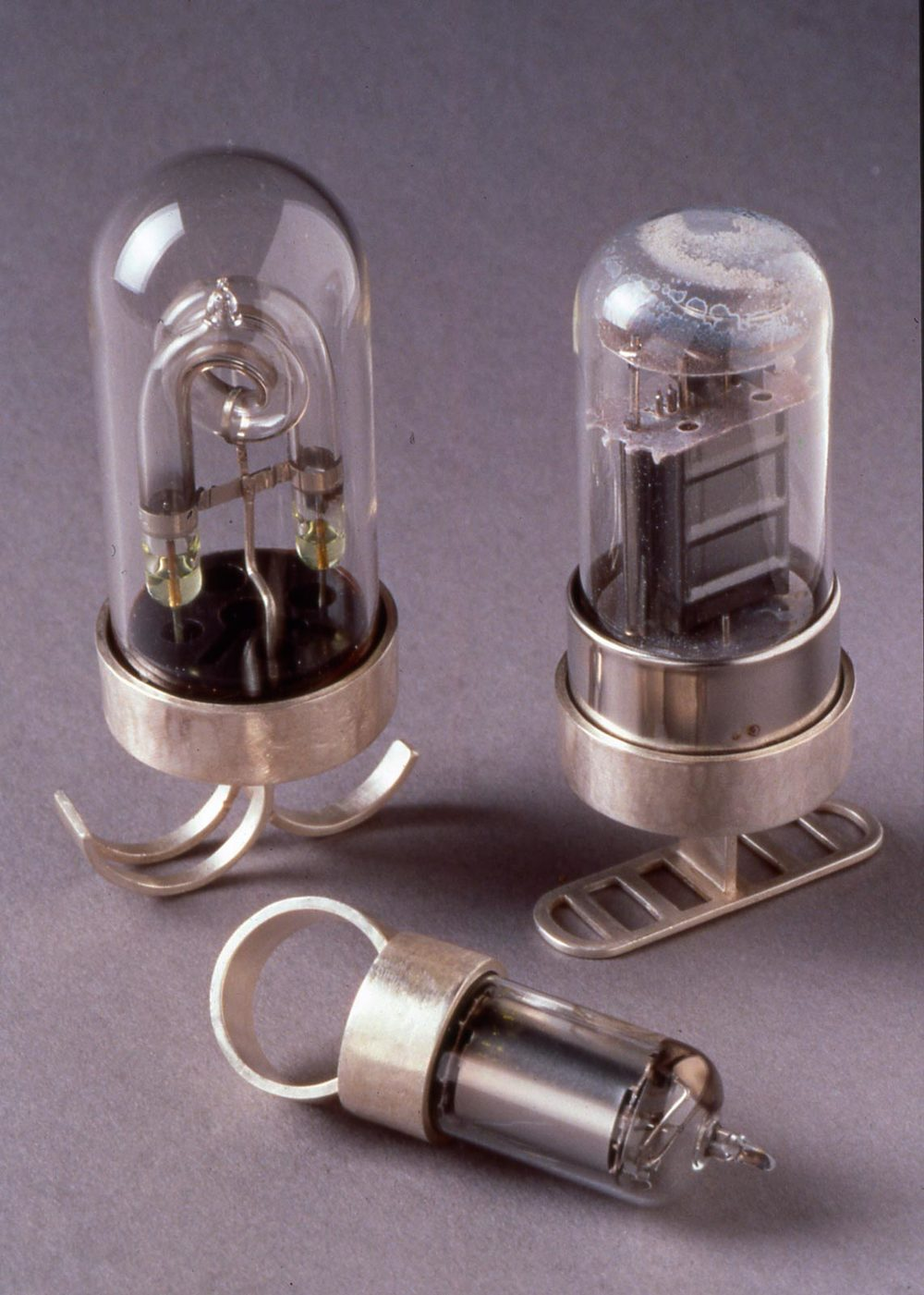 INTERMITTENT SERIES RINGS of vacuum tubes set in fabricated sterling silver, 9.3 x 3.4 centimeters, 2000. Photograph by Roger Schreiber.
