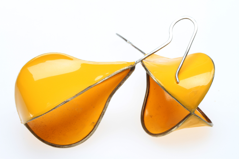 FINISHED FIG OR PEAR-SHAPED MATRIX EARRINGS, with only two of four sides covered. The Ultracote covering, while difficult to adhere, will heatshrink tightly, yielding these nice parabolic curves. Note that it is smoother than the unfinished earring, which had not yet been heated as much as this pair. Because both sides of the Ultracote are yellow, it gives the illusion that more than two sides are covered. I feel this design is the most successful application yet of heatshrinking, but it is difficult to execute successfully and repeatedly.