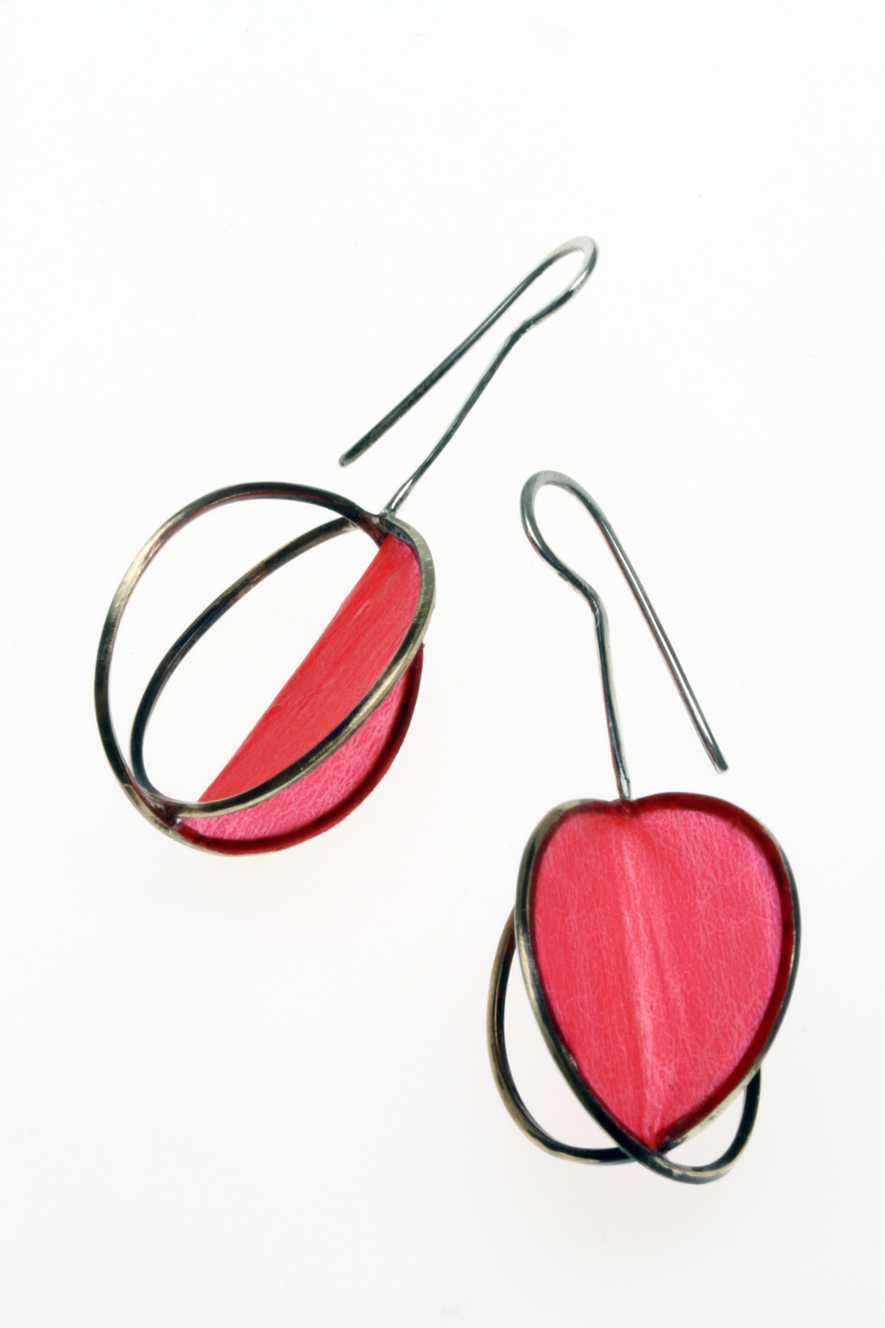 CROSSED COIL MATRIX EARRINGS, with one panel of Coverlite covering, are 5.4 cm high, 2015. The Coverlite conforms to the planes of the panel and is a matte finish. The brass wire was annealed, then wound on a wood dowel, much like one would make large jump rings. Nipped apart, ends filed square and soldered to form two crisscrossed rings. These are photographed with both reflective and transiluminated light. My bamboo and matrix jewelry is carried by Freehand Gallery, in Los Angeles.