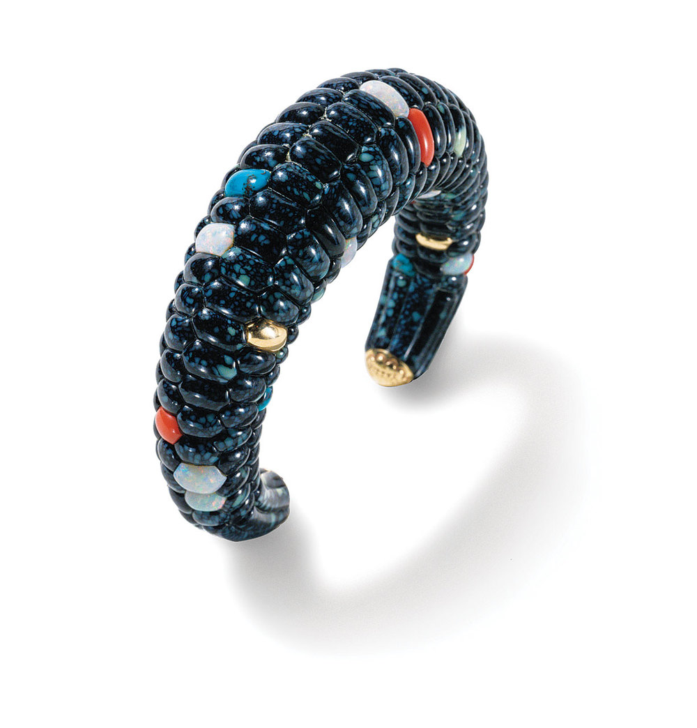 BLUE CORN BRACELET by Lee A. Yazzie of Bisbee and Royal Web turquoise, lapis lazuli, coral, opal, fourteen karat gold, 9.53 centimeters long, 1980.  Collection of Joe and Cindy Tanner. Photograph by Kiyoshi Togashi.