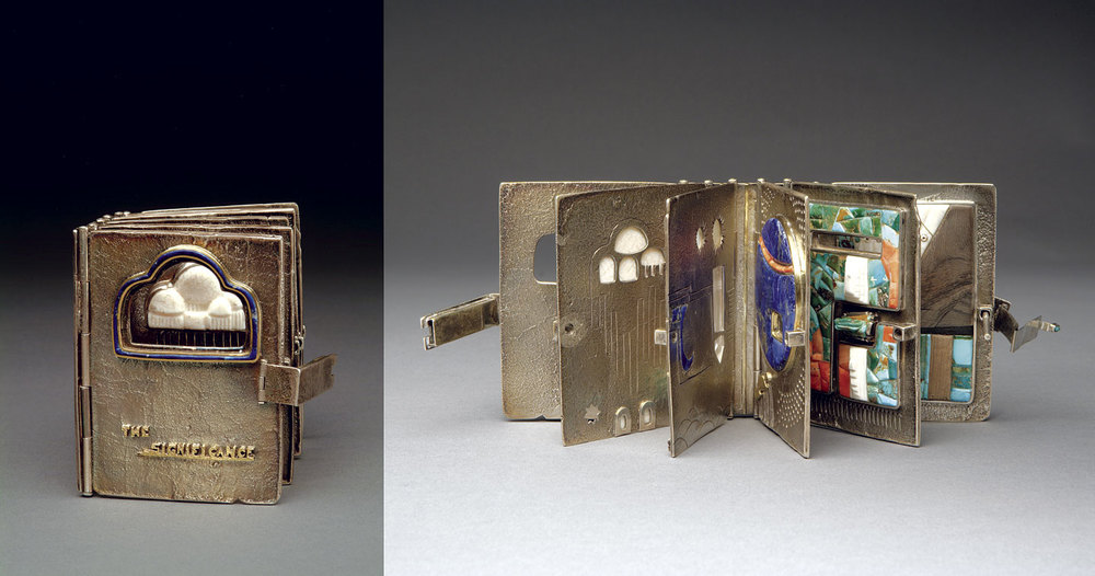 THE SIGNIFICANCE BOOK of silver and gold with turquoise, lapis lazuli, fossilized ivory, wood, coral, and other stones, fabricated, tufa-cast, 10.16 centimeters tall, circa 1980.  Private Collection .