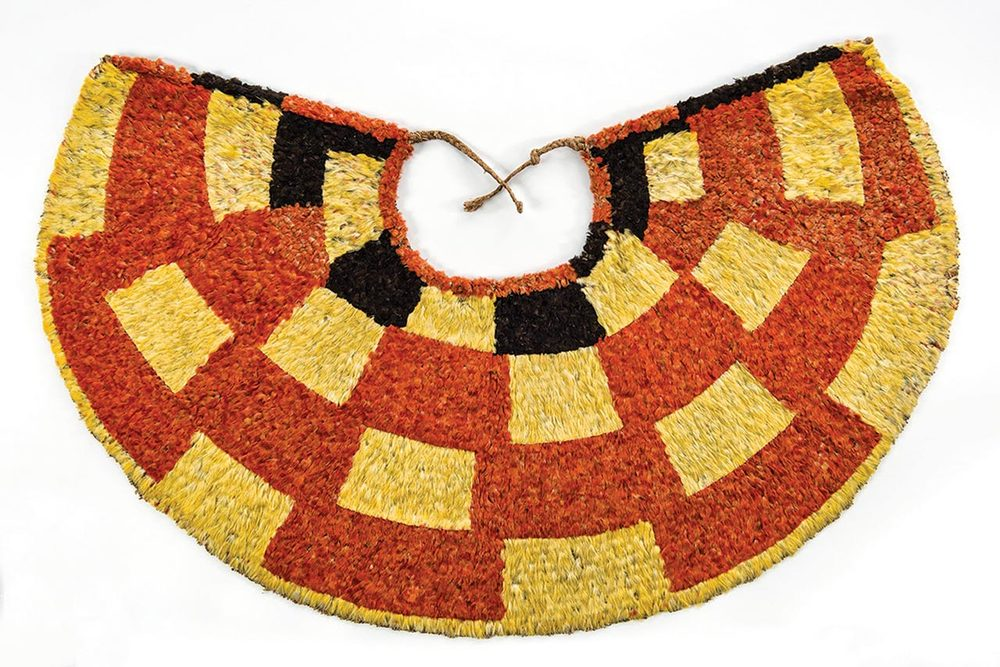 'AHU 'ULA cape of red  'i'iwi  ( Vestiaria coccinea ) feathers, yellow and blank  'o'o  ( Moho  sp.) feathers, and  olona  ( Touchardia latifolia ) fiber, 70 x 107 centimeters, early nineteenth century.  Bernice Pauahi Bishop Museum, Ethnology Collection.