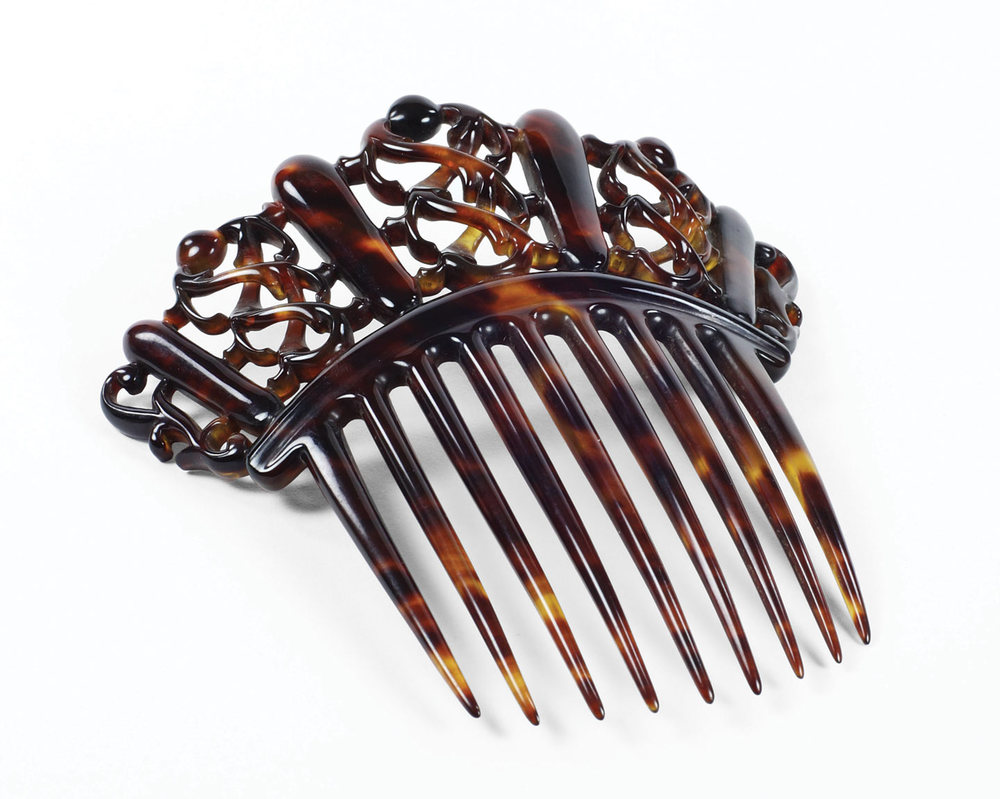 "CELLULOID COMB, English, circa 1880s. ""Hair jewels"" like this celluloid comb were popular gifts from husbands to wives however they were highly flammable."