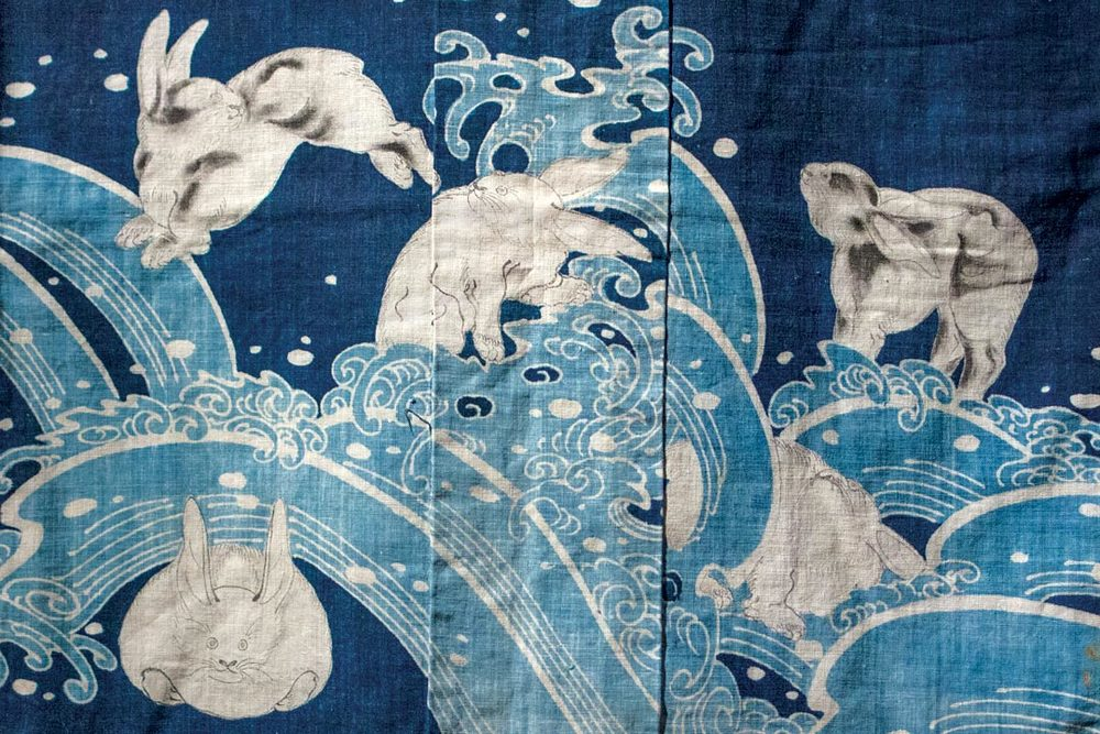JAPANESE COVERLET (detail) in kimono form  (yogi),  of cotton cloth with freehand paste-resist decoration  (tsutsugaki).   Gift of Virginia and Bagley Wright.