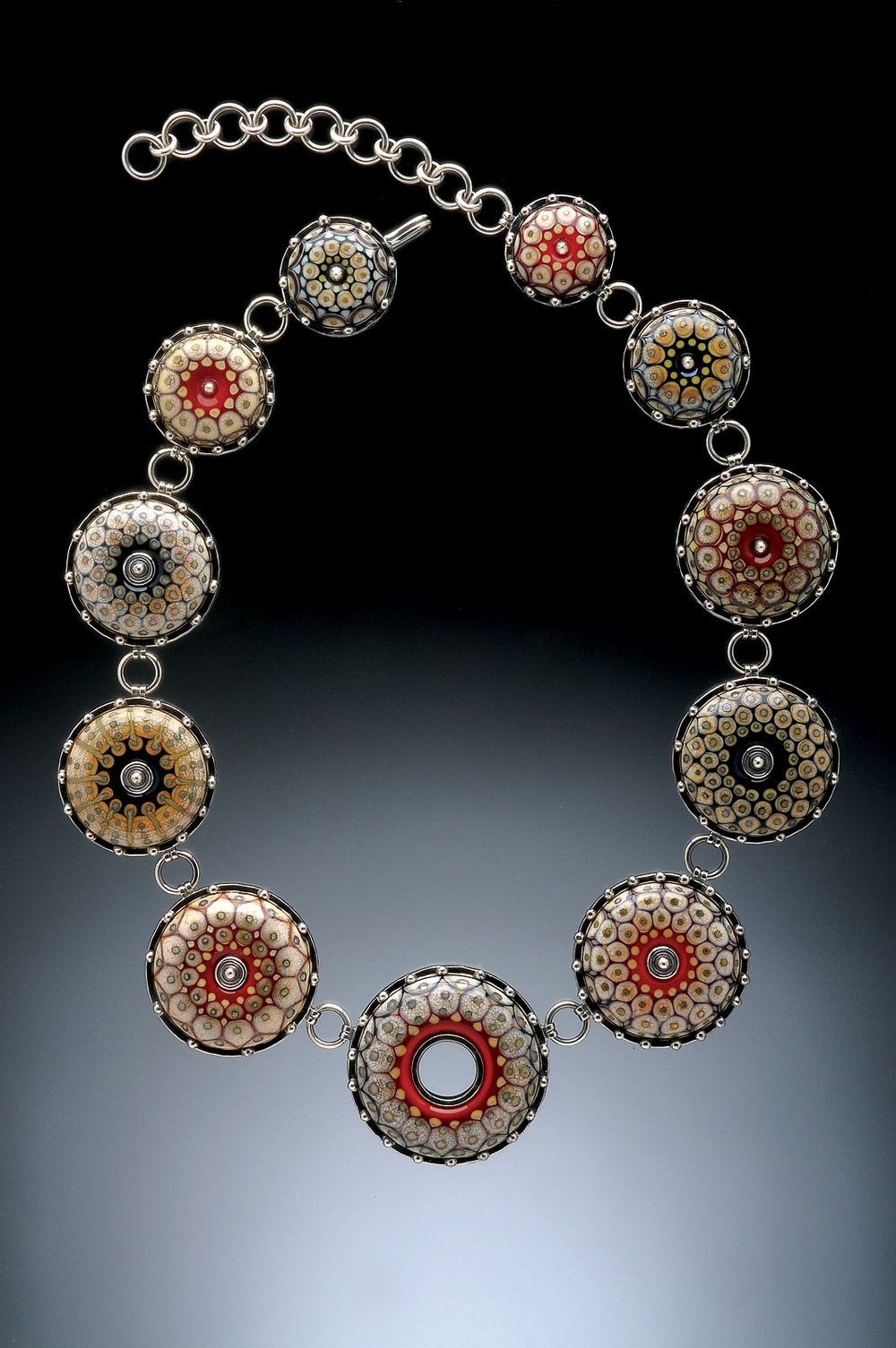 IVORY AND RED CONSTELLATION NECKLACE of flameworked glass and fabricated sterling silver, 4.45 x 1.27 x 66.04 centimeters, 2015. Photograph by Dean Powell.