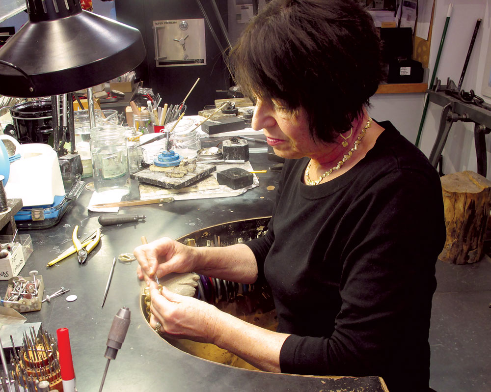 BARBARA HEINRICH AT HER STUDIO BENCH. Photograph courtesy of Barbara Heinrich Studio.