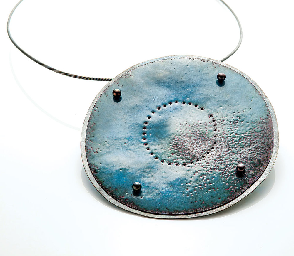 ONCE IN A BLUE MOON NECKLACE by Jan Smith of vitreous enamel, copper, sterling silver, pearls, and patina; 8.8 x 9 x 0.5 centimeters.