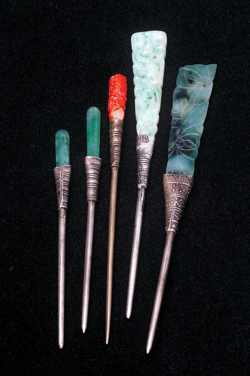 HAIRPINS DECORATED WITH GLASS SIMULATIONS OF JADE OR CORAL; these lapidary worked glass are set into decorated sheet metal cups and are excellent imitations of their more expensive prototypes. Size range 8.1 to 11.2 centimeters long.