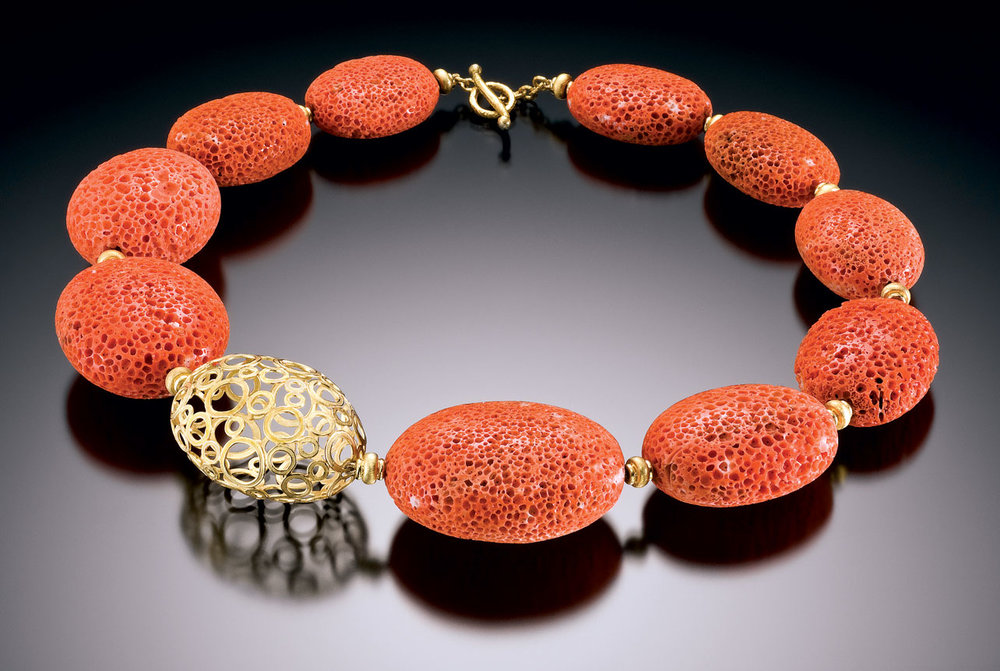 HEINRICH:  MEDITERRANEAN DECAY NECKLACE of coral and eighteen karat yellow gold oval bead, 2009.  Photograph by Hap Sakwa.