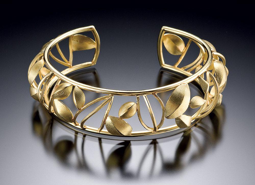 HEINRICH:  OPEN FRAME POD CUFF of eighteen karat gold, 2009.  Photograph by Hap Sakwa.